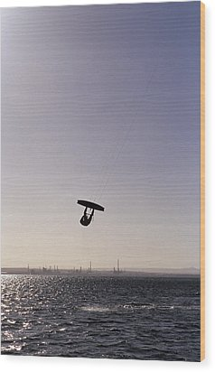 The Silhouette Of A Person Kite Wood Print by Jason Edwards