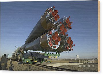 The Soyuz Rocket Is Rolled Wood Print by Stocktrek Images