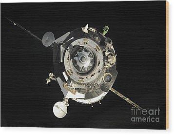 The Soyuz Tma-17 Spacecraft Departs Wood Print by Stocktrek Images