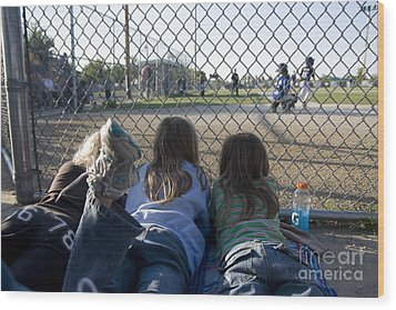 Three Girls Watching Ball Game Behind Home Plate Wood Print by Christopher Purcell