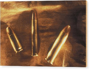 Three Golden 38 Calibre Bullets Wood Print by Lyle Leduc