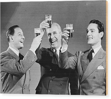 Three Men Making Toast With Glasses Of Beer (b&w) Wood Print by Hulton Archive