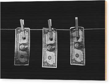 Three One Dollar Bill Banknotes Hanging On A Washing Line With Blue Sky Wood Print by Joe Fox