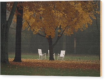 Three Welcoming Rocking Chairs Under An Wood Print by Paul Chesley
