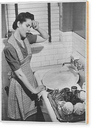 Tired Woman At Kitchen Sink, (b&w), Elevated View Wood Print by George Marks