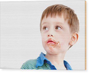 Toddler Eating Chocolate Wood Print by Tom Gowanlock