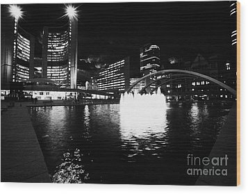 Toronto City Hall Building And Reflecting Pool In Nathan Phillips Square At Night Wood Print by Joe Fox