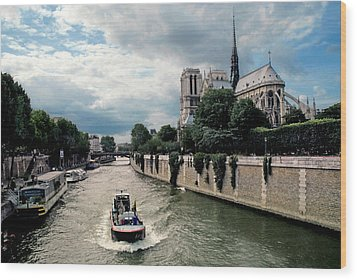 Wood Print featuring the photograph Tour Boat Passing Notre Dame by Dave Mills