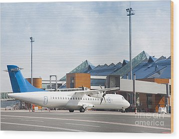 Transport Plane At The Airport Wood Print by Jaak Nilson