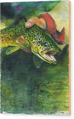 Trout In Hand Wood Print by John D Benson