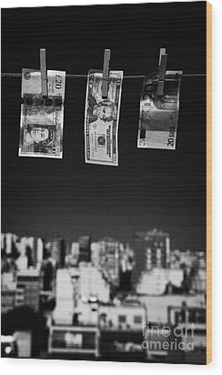 Twenty Pounds Dollars Euro Banknotes Hanging On A Washing Line With Blue Sky Over City Skyline Wood Print by Joe Fox