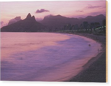 Twilight View Of Ipanema Beach And Two Wood Print by Michael Melford
