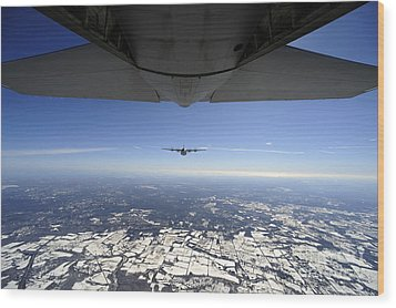 Two Ec-130j Commando Solo Aircraft Fly Wood Print by Stocktrek Images