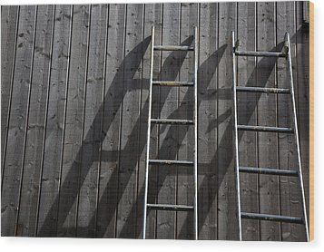 Two Ladders Leaning Against A Wooden Wall Wood Print by Meera Lee Sethi