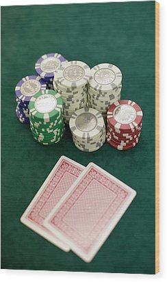 Two Playing Cards And Piles Of Gambling Chips On A Table, Las Vegas, Nevada Wood Print by Christian Thomas
