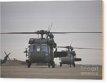 Two Uh-60 Black Hawks Taxi Wood Print by Terry Moore