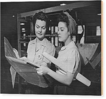 Two Women In Workshop Looking At Blueprints, (b&w) Wood Print by George Marks