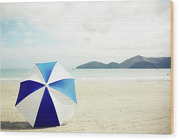 Umbrella On Sand Wood Print by Grace Oda