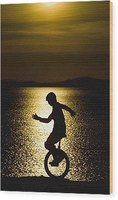 Unicycling Silhouette Wood Print by Deddeda