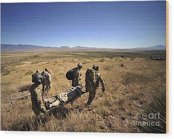 U.s. Air Force Pararescuemen Carry Wood Print by Stocktrek Images