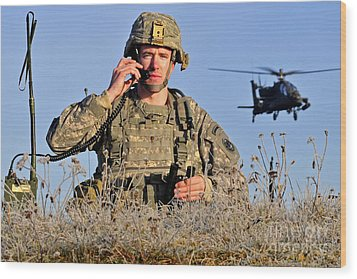U.s. Army Captain Directs An Ah-64 Wood Print by Stocktrek Images