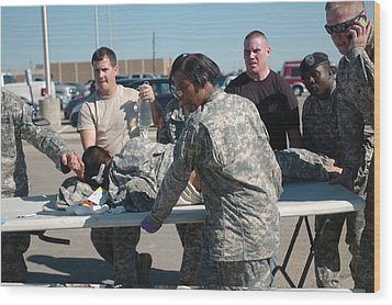 Us Army First Responders Use A Table Wood Print by Everett