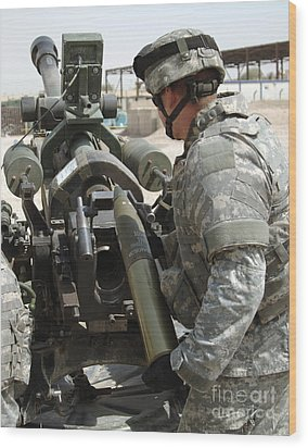 U.s. Army Soldier Loads A 105mm Wood Print by Stocktrek Images