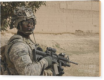 U.s. Army Soldier Scans His Area While Wood Print by Stocktrek Images