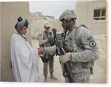 U.s. Army Soldier Shakes Hands With An Wood Print by Stocktrek Images