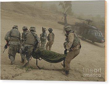 U.s. Army Soldiers Medically Evacuate Wood Print by Stocktrek Images