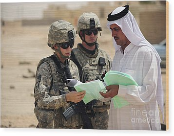 U.s. Army Soldiers Talking With A Town Wood Print by Stocktrek Images