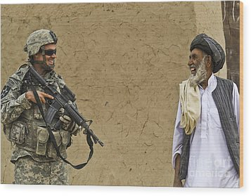 U.s. Army Specialist Talks To An Afghan Wood Print by Stocktrek Images