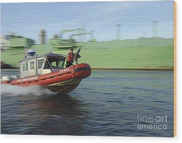 U.s. Coast Guard Officer Mans A M240b Wood Print by Stocktrek Images