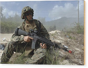 U.s. Marine Takes Part In An Amphibious Wood Print by Stocktrek Images