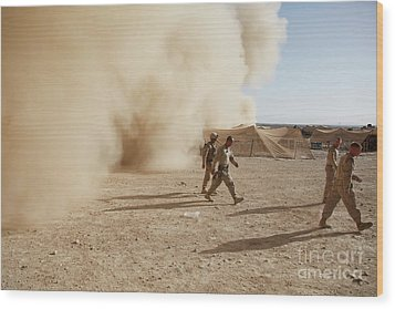 U.s. Marines Walk Away From A Dust Wood Print by Stocktrek Images