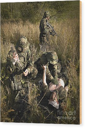 U.s. Navy Seals Give First Aid Wood Print by Tom Weber