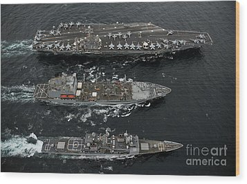 U.s. Navy Ships Conduct A Replenishment Wood Print by Stocktrek Images