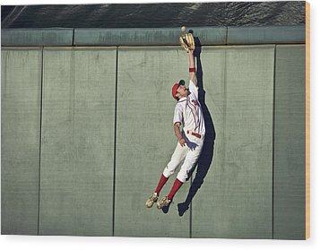 Usa, California, San Bernardino, Baseball Player Making Leaping Catch At Wall Wood Print by Donald Miralle