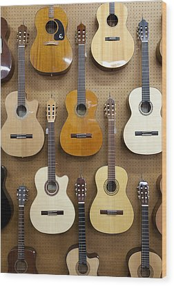 Various Guitars Hanging From Wall Wood Print by Lisa Romerein