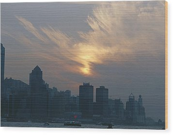 View Of The Hong Kong Skyline At Sunset Wood Print by Raul Touzon