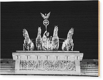 viktoria with quadriga on top of the Brandenburg gate at night Berlin Germany Wood Print by Joe Fox