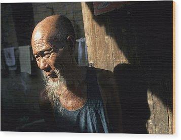 Village Elder At Doorway, Yangdi Wood Print by Raymond Gehman