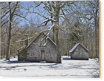 Vintage Buildings In The Winter Snow Wood Print by Susan Leggett