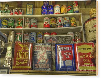 Vintage Garage Oil Cans Wood Print by Bob Christopher