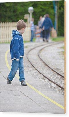 Waiting For Train Wood Print by Tom Gowanlock