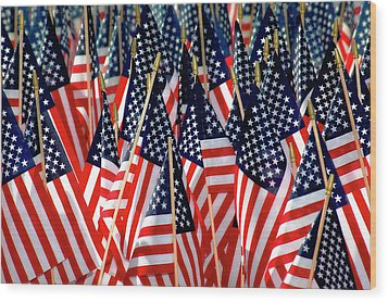 Wall Of Us Flags Wood Print by Carolyn Marshall