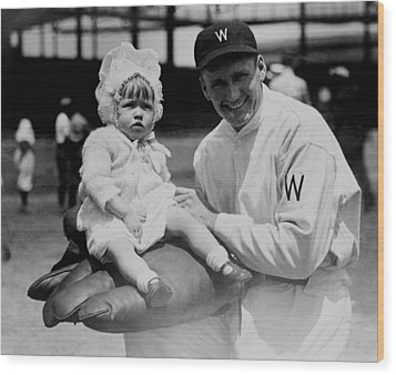 Wood Print featuring the photograph Walter Johnson Holding A Baby - C 1924 by International  Images