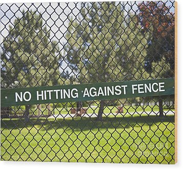 Warning Sign On Chain Fence Wood Print by Thom Gourley/Flatbread Images, LLC