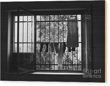Washing Hanging Off Security Cage In An Apartment In Buenos Aires Wood Print by Joe Fox