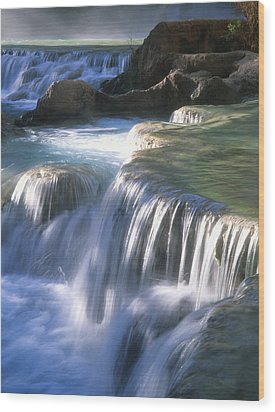 Water Flowes Over Travertine Formations Wood Print by Bill Hatcher
